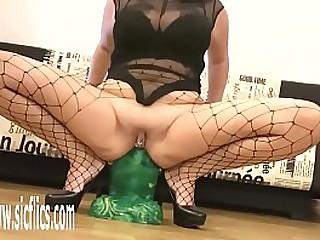 Esurient MILF Shagging her loose bore with a Goliath dildo